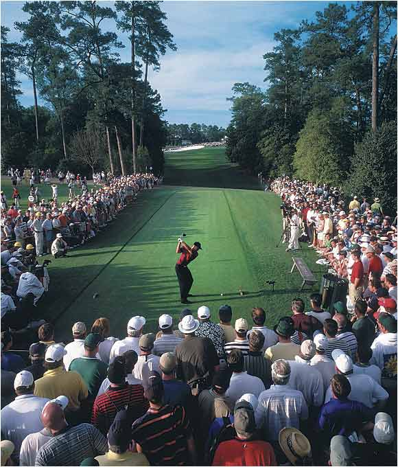 A packed crowd watches Woods tee off on the 18th hole of the final round. Tiger held off David Duvall and Phil Mickelson to take home his forth straight major to complete the Tiger Slam.