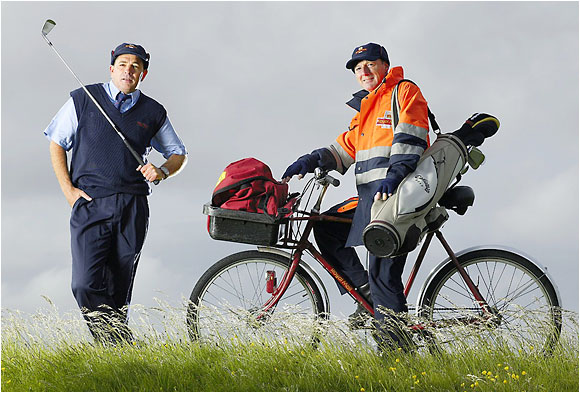 "<b>POSTMEN, Dave Kilty (left) and Dave Adamson: </b>""I deliver mail by bike in Hoylake. Now, with the Internet, I'm delivering many more golf clubs. I know the club members on my route. Their mail from the club has a special Open stamp that has the claret jug right on it."""