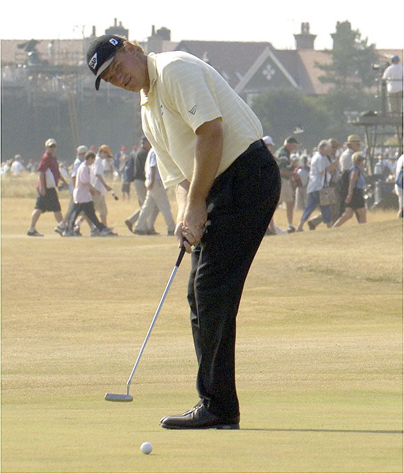 Ernie Els, who won the Claret Jug in 2002, matched Woods with a 65 to trail by one shot.