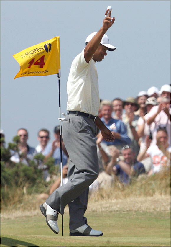 In a career filled with memorable shots, Tiger Woods added another Friday with a 209-yard eagle on No. 14.