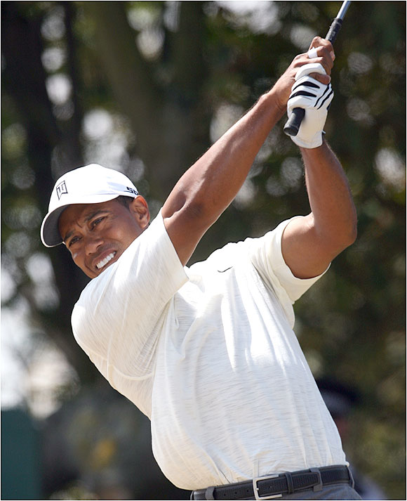 Woods finished with a 7-under-par 65 to take a one-shot lead in his bid to become the first repeat winner since Tom Watson in 1982 and '83.