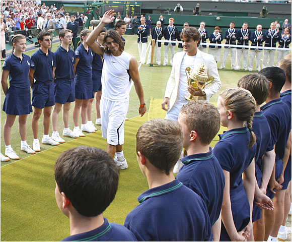 Roger Federer (right) leaves Centre Court as the third player in the Open era to capture four successive Wimbledon titles, joining Bjorn Borg (five straight from 1976-80) and Pete Sampras (1997-00).