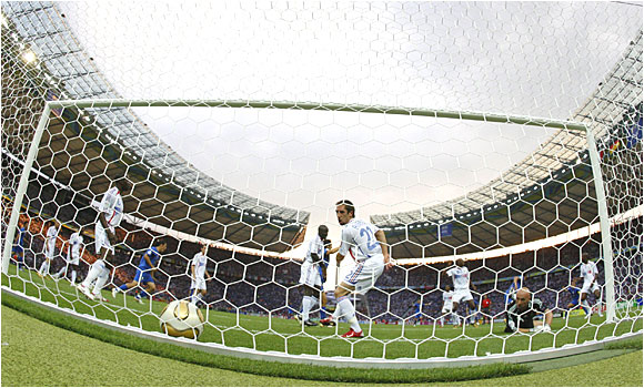 France goalie Fabian Barthez and Franck Ribery (22) watch as Marco Materazzi's header finds the back of the net in the 18th minute.