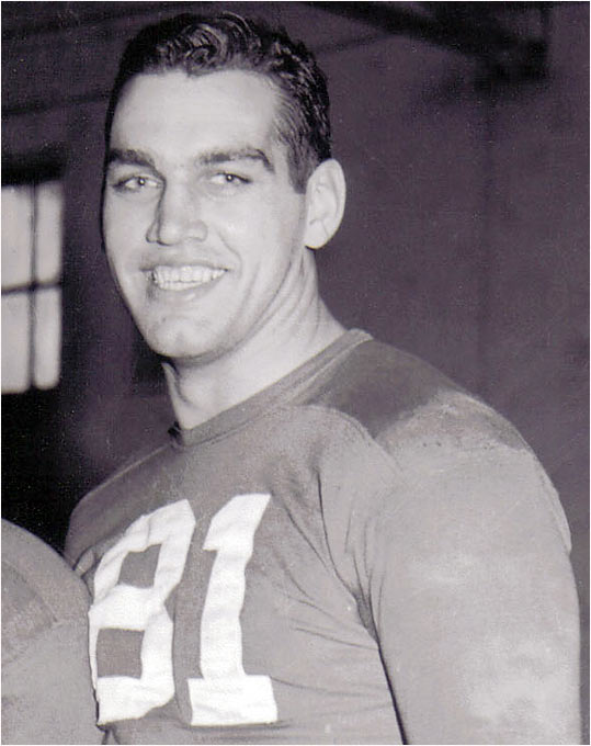 "Considered the greatest lineman in school history, he transferred from Holy Cross after World War II and was a two-way, two-time consensus All-American for two national champs that never trailed in a game and yielded only 76 points in 18 contests. Selected to Sports Illustrated's ""All-Century"" (1869-1969) college football team and the first recipient of the Outland Trophy, he combined exceptional strength with speed -- even receiving a Hollywood audition to replace Johnny Weissmuller in the role of Tarzan."