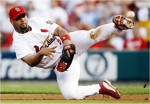 Albert Pujols attempts a throw to first after diving to field a ball on Aug. 1 against the Phillies. The Cardinals lost 5-3 in the first game of a three-game sweep by the Phillies.