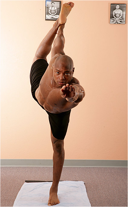 Posture: Stand on left leg, bend right leg behind. Grasp instep of right foot with right hand. Extend left arm straight out. Bend forward until abdomen and arm are parallel to the floor. At the same time kick right leg straight up behind you. Hold for 10 counts, return to start position. Switch legs. Repeat.
