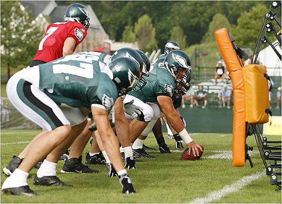 Center Hank Fraley and the Eagles offensive line are hoping to do a better job of protecting Donovan McNabb this season.