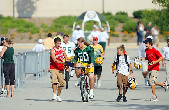 It didn't take Packer rookie A.J. Hawk long to get in on the Green Bay tradition of riding a bike to the practice field.