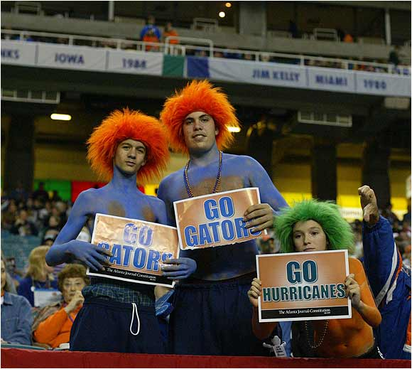 A Hurricanes fan tries to get in his two cents, but is outnumbered by Florida faithful before the 2004 Peach Bowl in Atlanta.