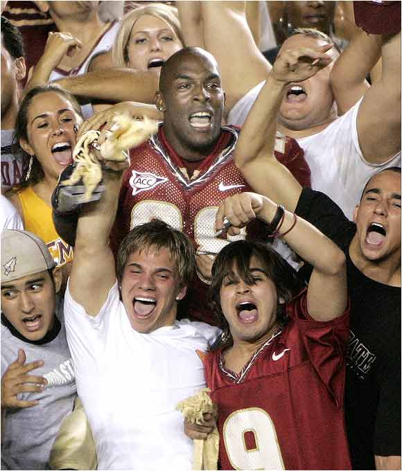 FSU running back Lorenzo Booker, top center, celebrated with fans following FSU's 10-7 win over Miami last September.