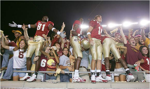 Florida State players celebrate with fans after beatin the Miami Hurricanes, 10-7, last September.