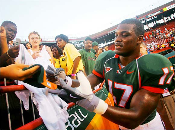 Ex-Miami linebacker Willie Williams scrawled his autograph for fans after a 52-7 victory over Duke last October.