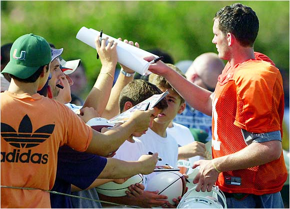 Miami quarterback Ken Dorsey signed autographs for fans who came out to watch the Hurricanes scrimmage at the Miami campus in August, 2002.