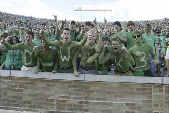 "Notre Dame fans showed their support for Darius Walker by painting ""D Walk 3"" on their chests during a game against Washington in September, 2004."