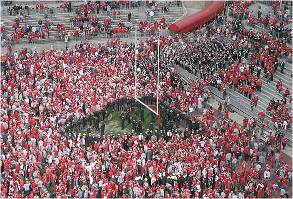 Columbus Police were positioned as a wedge to keep fans from the goalpost after Ohio State beat Michigan, 37-21 on Nov. 20, 2004, in Columbus, Ohio.