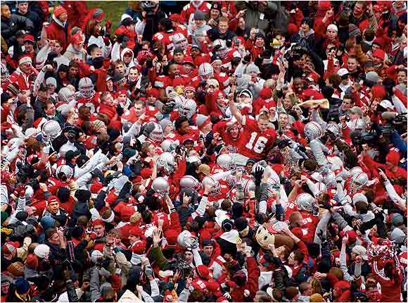 Ohio State fans flooded the field and carried quarterback Craig Krenzel (16) on their shoulders after the Buckeyes defeated Michigan in November 2002.