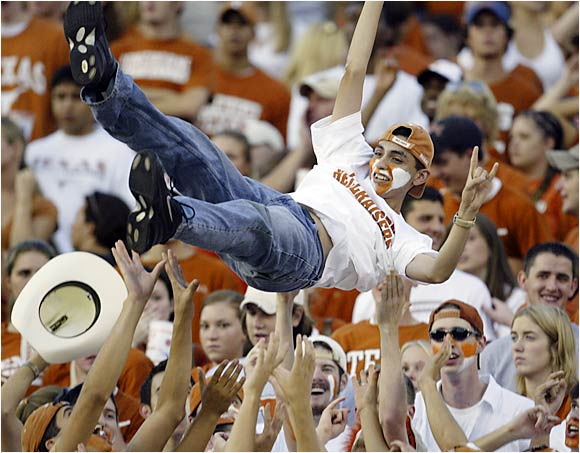Crowdsurfing is one way to celebrate a touchdown, as this Longhorn fan showed during a September 2003 game against Tulane.