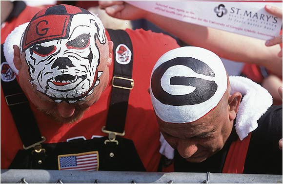 You know you're a UGA fan if you find yourself with a perfectly painted bulldog on your bald skull.