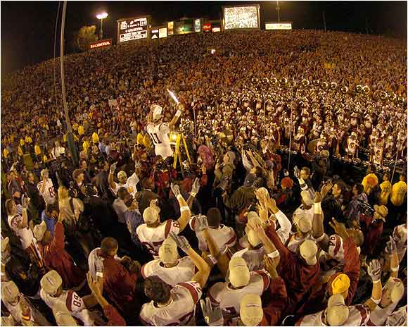 Matt Leinart used the mascot's sword as a baton while leading the USC marching band after the Trojans' 28-14 triumph over Michigan in the 2004 Rose Bowl.