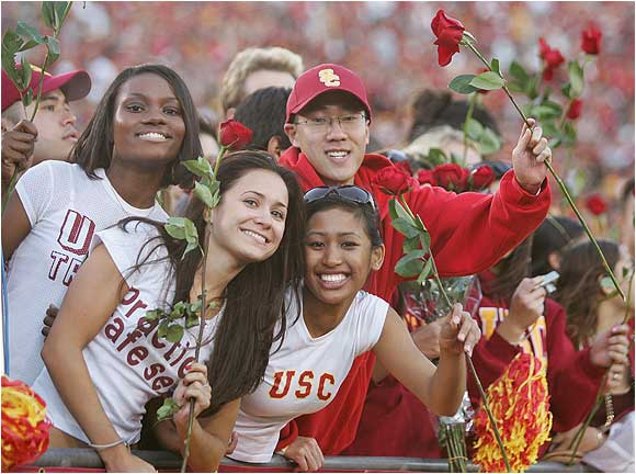 USC fans hold roses after the Trojans defeated UCLA 66-19 on December 3, 2005. The win clinched USC's national championship appearance at the Rose Bowl.