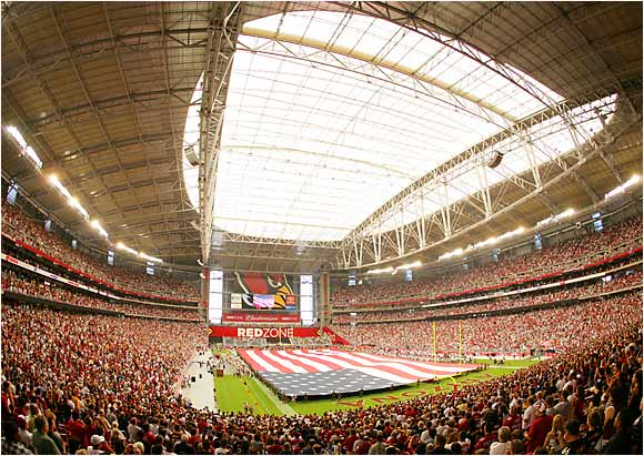 A sellout crowd of 63,400 observes the singing of the national anthem during the unveiling of Cardinals Stadium in Glendale, Ariz., before a preseason game with the Steelers.