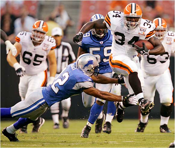 Browns running back Reuben Droughns hurdles past Lions safety Terrence Holt in a preseason game at Cleveland Browns Stadium.