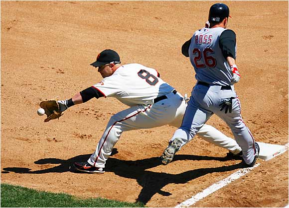 The throw from Giants third baseman Pedro Feliz to first baseman Shea Hillenbrand just beats the Reds' David Ross in the fourth inning at AT&T Park on Saturday.