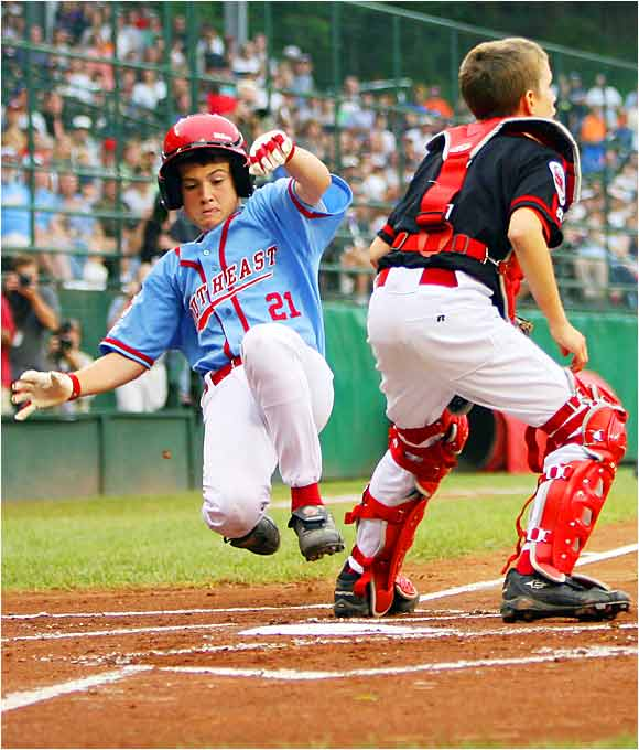 Cody Walker of the Southeast team from Georgia slides home safely ahead of the throw to Trevor Nix of the Northwest team from Oregon in the U.S. championship game of the Little League World Series last Saturday in Williamsport, Pa. Walker hit a two-run homer on Monday, which was enough to beat Japan 2-1 in the title game.