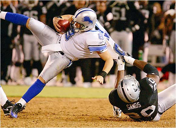 Raiders defensive tackle Terdell Sands sacks Lions quarterback Jon Kitna in the second quarter of a preseason game at McAfee Stadium in Oakland on Aug. 25.