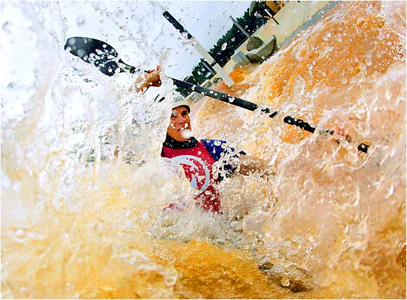 Three-time Olympian Scott Shipley kayaks on one of the slalom courses he designed at the new U.S. National Whitewater Center in Charlotte on Aug. 24.