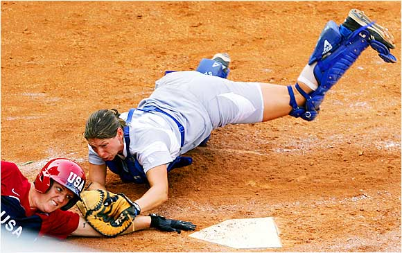 Italy's Kaitlyn Gentile dives to tag out Team USA's Stacey Nuveman on the first day of the Women's Fast Pitch Softball World Championship in Beijing on Sunday.