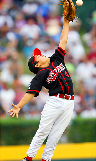Beaverton third baseman Toma Matisoff jumps in vain to reach a ball hit by Columbus.