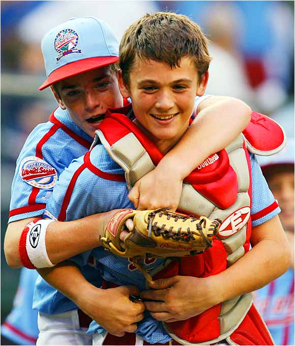 Columbus center fielder Brady Hamilton and catcher Cody Walker celebrate their 7-3 victory over Beaverton, which put Columbus in the LLWS championship game.
