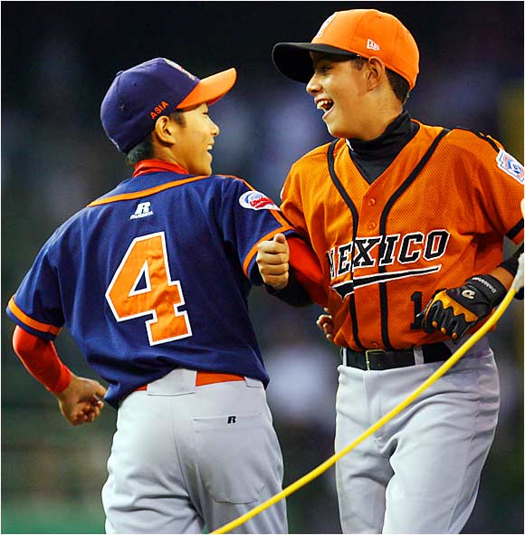 Japan's Hayato Hozumi and Mexico's Isaac Lambarri dance on the field during pregame festivities to promote sportsmanship before the international championship game.