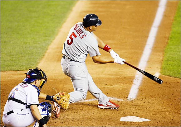 Albert Pujols belts a grand slam at Shea Stadium as Mets catcher Paul Lo Duca looks on in the fifth inning on Aug. 22. Pujols had hit a three-run shot in the fourth, accounting for all of the Cardinals' runs in an 8-7 loss to the Mets.