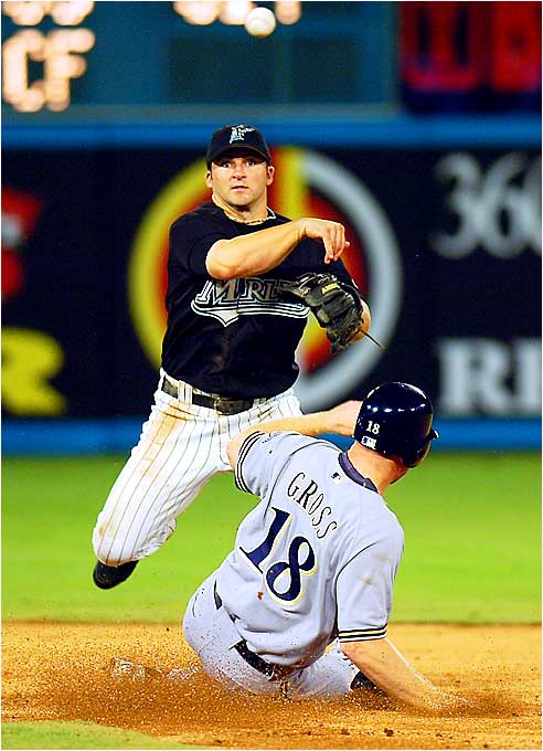 Marlins second baseman Dan Uggla turns a double play after forcing out Milwaukee's Gabe Gross in the third inning at Dolphin Stadium on Aug. 25. The Marlins had a seven-game winning streak through Sunday, with six of those wins by two runs or fewer.