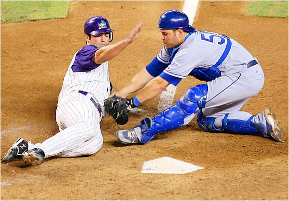 Dodgers catcher Russell Martin tags out the Diamondbacks' Conor Jackson at home on a fielder's choice in the fifth inning at Chase Field on Aug. 25. The D-backs won 9-7 with a two-run shot by Orlando Hudson in the 15th, but the Dodgers took the next two games to remain atop the NL West.