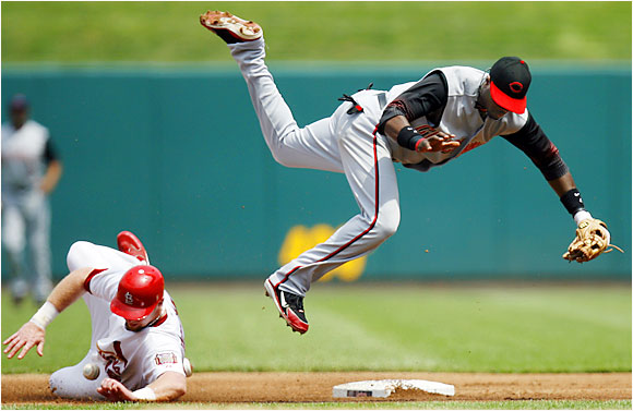 The Cardinals' Chris Duncan breaks up a double play attempt by Reds second baseman Brandon Phillips during a 2-1 victory for the Cards at Busch Stadium on Aug. 17. Duncan had nine hits in the three-game series and followed it by hitting a home run in each of three games against the Cubs.