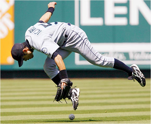 Mariners center fielder Ichiro Suzuki fails to grab a ground ball hit by Jose Molina in the fifth inning at Angel Stadium on Aug. 20. Seattle lost the game 3-2, extending its losing streak to 11.