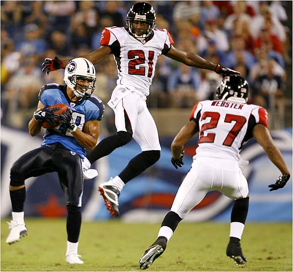 Bobby Wade of the Titans caught this pass for 17 yards as the Falcons' DeAngelo Hall defended.