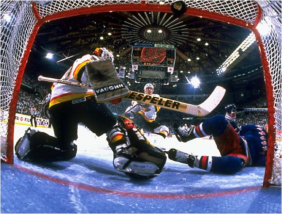 """Netcam"" shot of New York Rangers Alexei Kovalev scoring against Vancouver Canucks goalie Kirk McLean.  May 31, 1994."