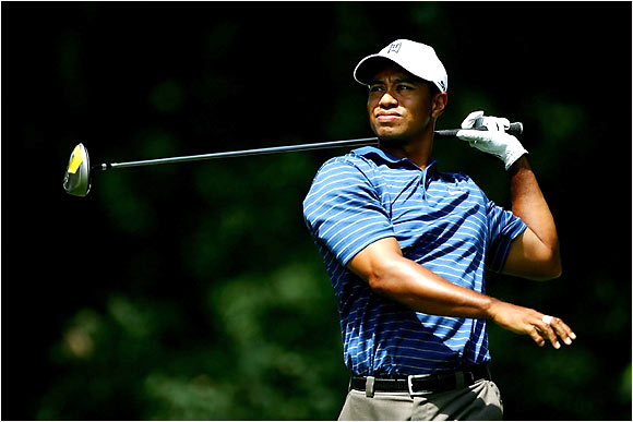 Tiger Woods hits a tee shot on the 6th hole.