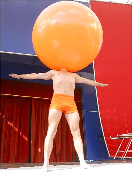 Lars Lottrup stands with his head in a balloon at the International Clown Festival in Copenhagen, Denmark. Nothing else needs to be said.