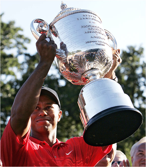Tiger Woods becomes the first player in PGA Championship tournament history to win twice on the same course. He captured his first PGA at Medinah Country Club in 1999.