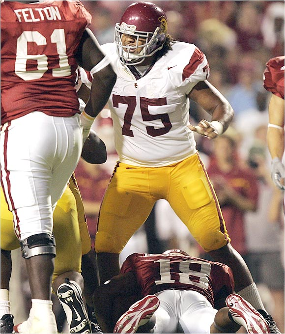 Fili Moala (75) and the Trojans defense harassed quarterback Robert Johnson (18) and the Razorbacks.