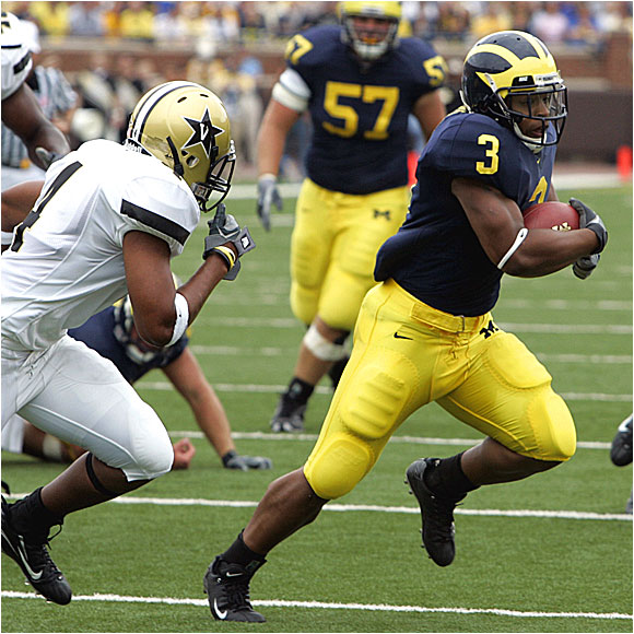 Kevin Grady (3) ran for 30 yards as the Wolverines totaled 246 yards on the ground against the Commodores.