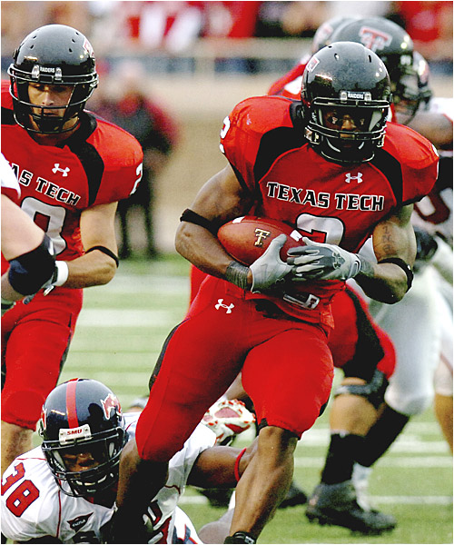 Shannon Woods (right) ran for 103 yards in the Red Raiders' win.