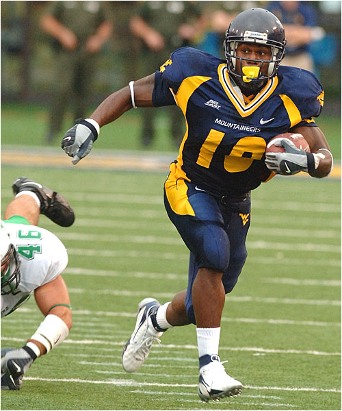 Steve Slaton, who had 140 rushing yards at the half, totaled 203 yards and two touchdowns on 33 carries.