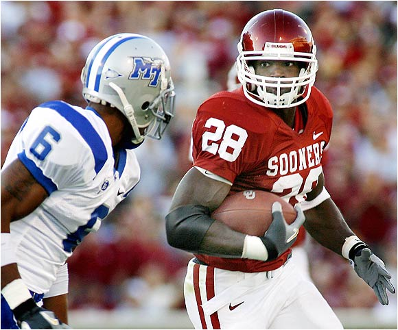 Adrian Peterson had 128 yards rushing and three touchdowns to help the Sooners hand Middle Tennesse its largest margin of defeat since moving to Division I-A in 1999.