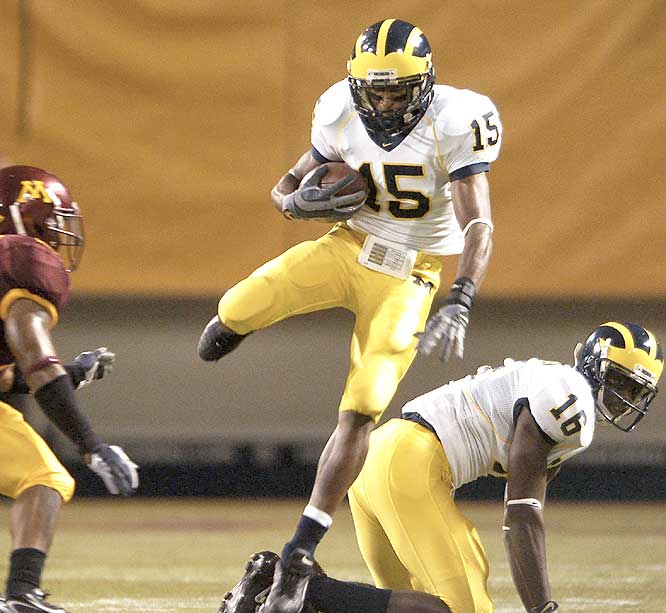 Steve Breaston (15) and the Wolverines got back at the Golden Gophers, returning the Little Brown Jug to Ann Arbor.